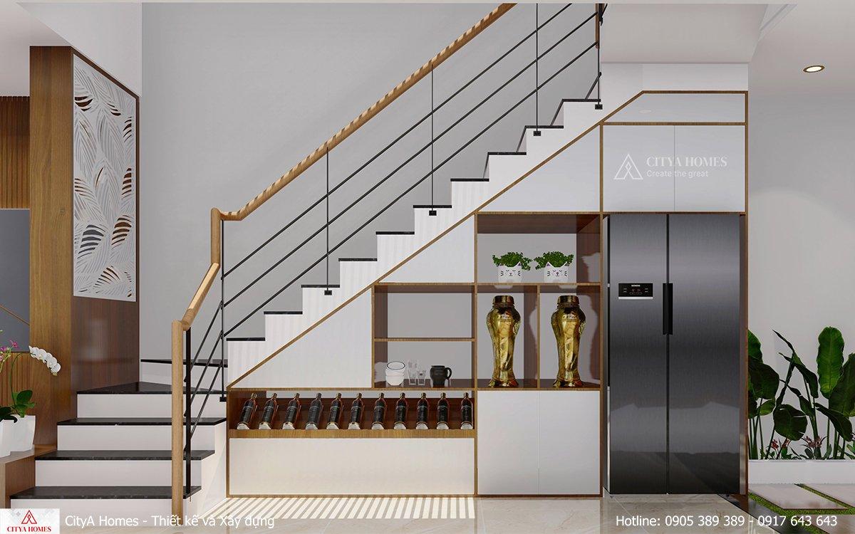 Góc dưới cầu thang được tận dụng làm kệ đựng rượu sáng tạo