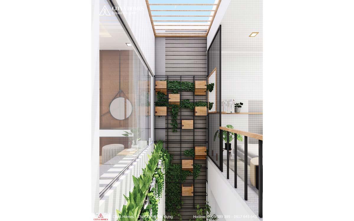 Hệ giếng trời trài dài từ tầng 2 xuống tầng trệt, đem thiên nhiên đến mọi ngóc ngách trong nhà