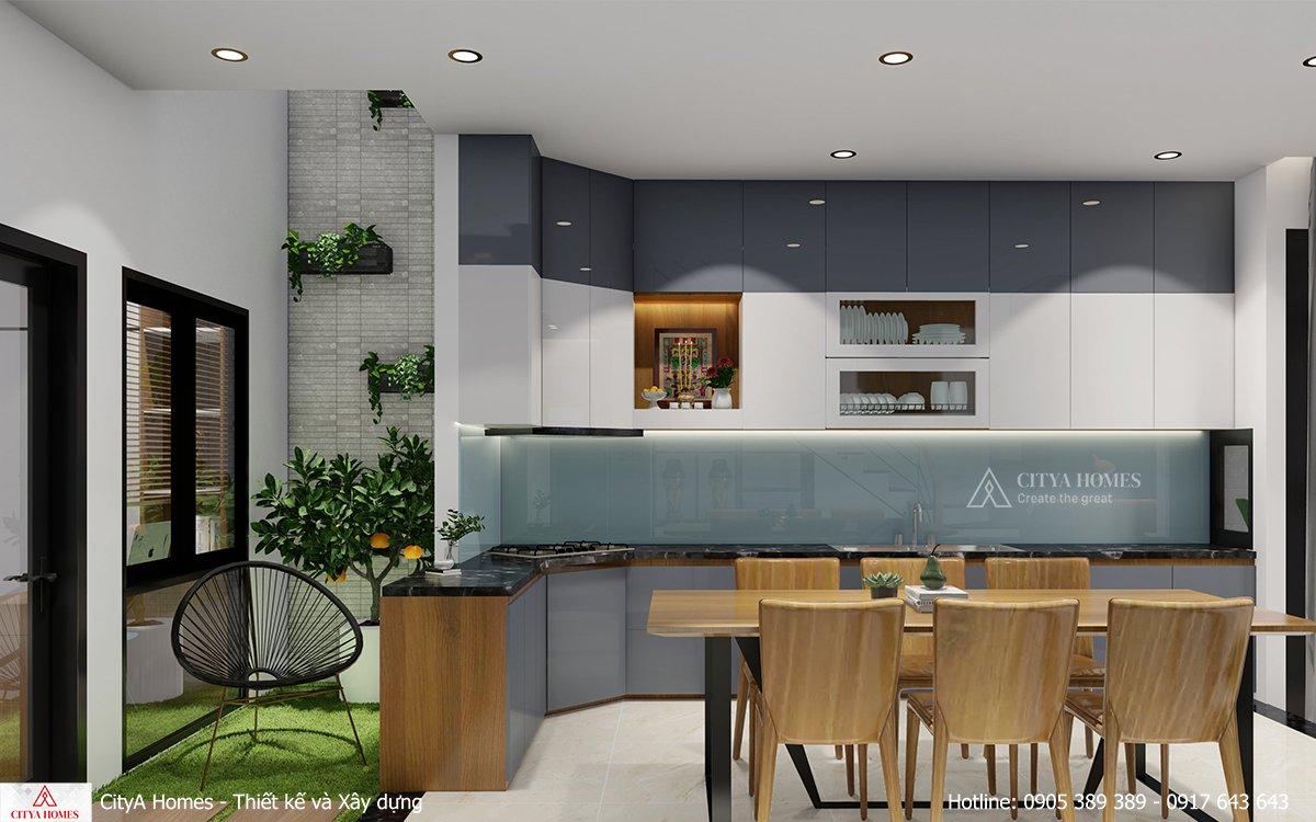 Phòng bếp tối tân được đặt cạnh giếng trời để tăng khả năng thông gió trong nhà