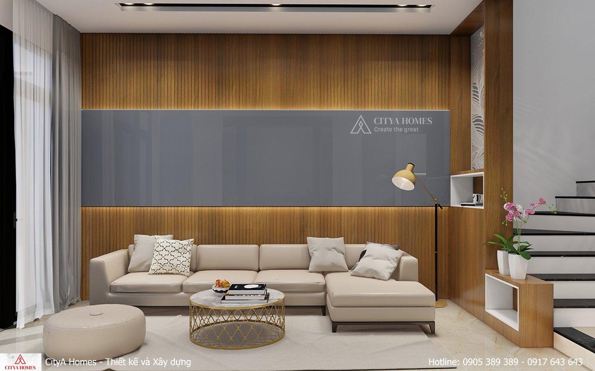 Phòng khách có tone màu sáng cùng lam gỗ tự nhiên tạo nét tinh tế, trang nhã