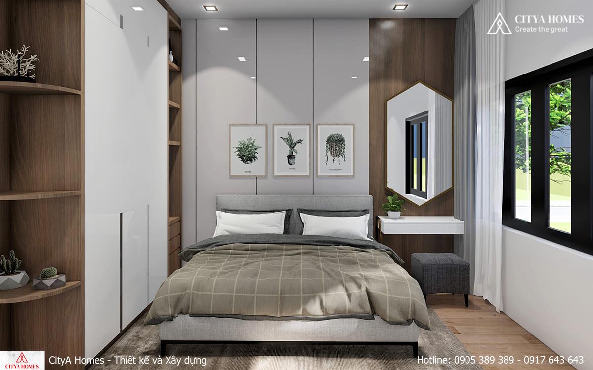 Phòng ngủ được đón nắng nhờ cửa kính rộng