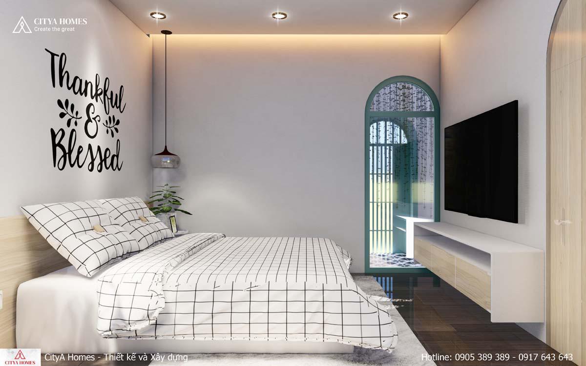 Phòng ngủ được thiết kế với nội thất kẻ sọc tinh tế