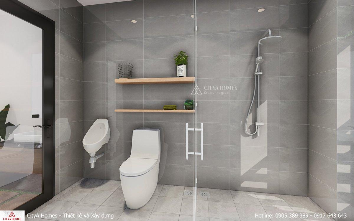 Phòng tắm rộng rãi với tone màu xám trắng.