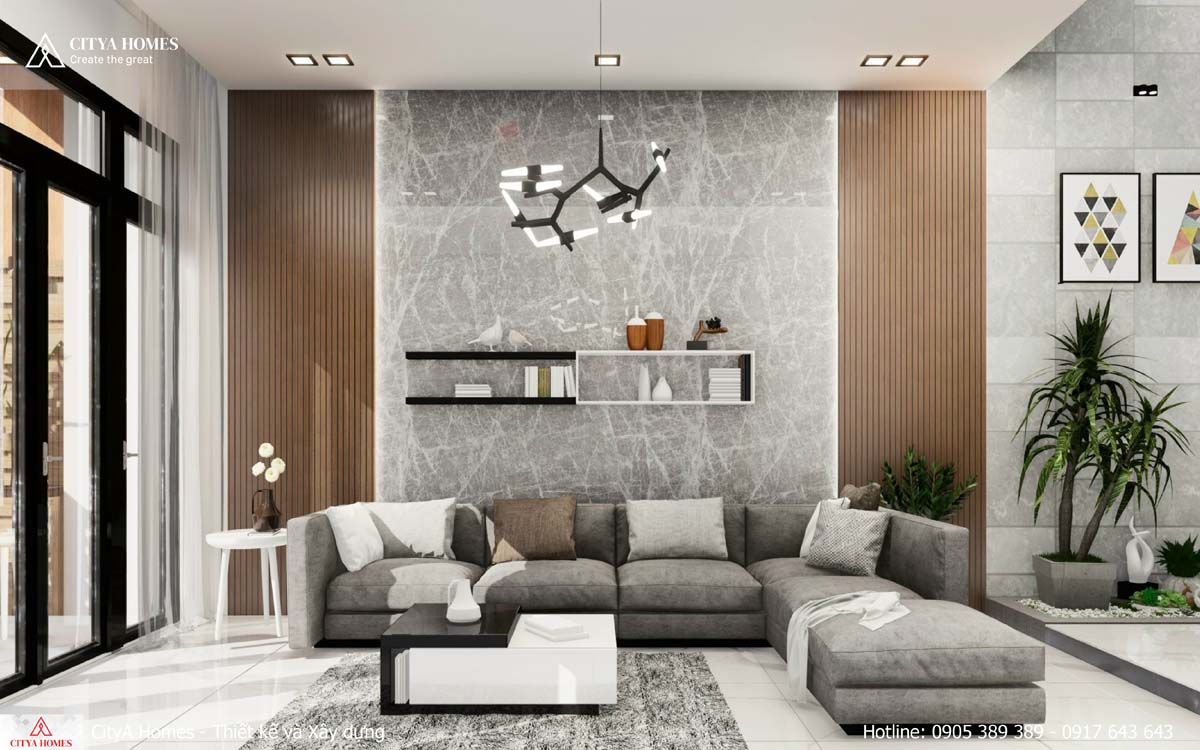 Sofa ghi xám được đưa vào tăng nét sang trọng cho phòng khách