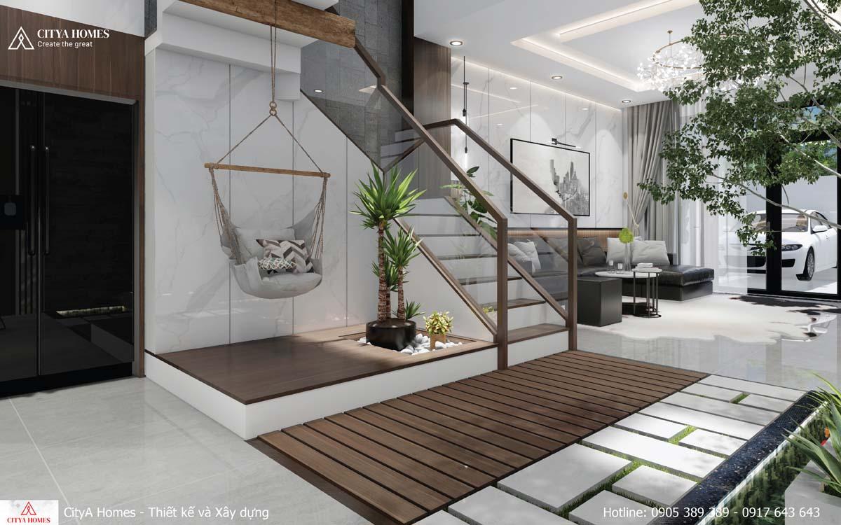 Góc khuất của cầu thang được tận dụng làm tiểu cảnh kết hợp ghế mây thư giãn cho chủ nhà